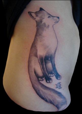 Sitting Animal And Asian Symbol Tattoos