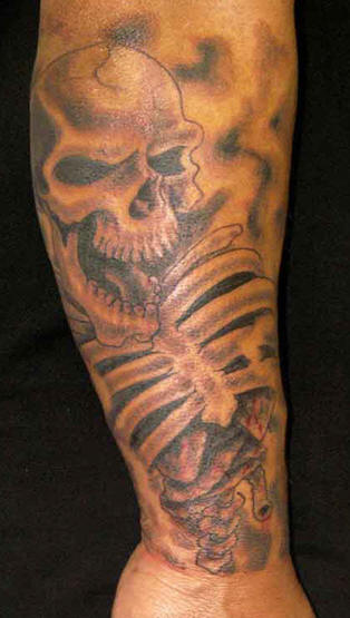 Skeleton Bones Tattoo On Arm