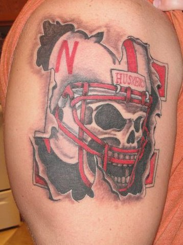 Skull Helmet Ripped Skin Tattoo On Biceps