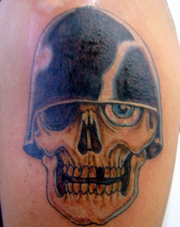 Skull In Helmet Tattoo