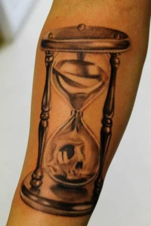 Skull In Hourglass Tattoo