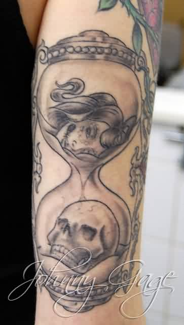 Skull In Sand Glass Tattoo On Arm