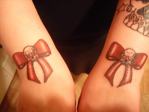 Skull Ribbon Bow Tattoos On Wrist