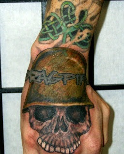 Skull Wearing Helmet Tattoo On Hand