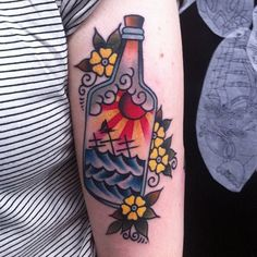 Small Flowers And Bottle Tattoos On Arm
