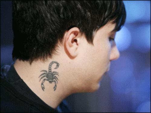 Small Grey Scorpion Tattoo On Neck Of Boy