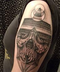 Small Pyramid And Skull Tattoo On Biceps