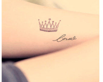Small Queen's Crow And Word Tattoos On Wrist