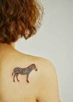 Small Zebra Tattoo On Back Of Shoulder