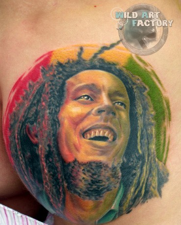Smiling Bob Marley Colored Portrait Tattoo On Chest