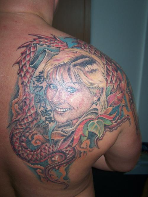 Smiling Girl And Snake Portrait Tattoos On Back Shoulder