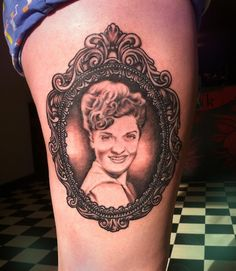 Smiling Lady Portrait In Frame Tattoo