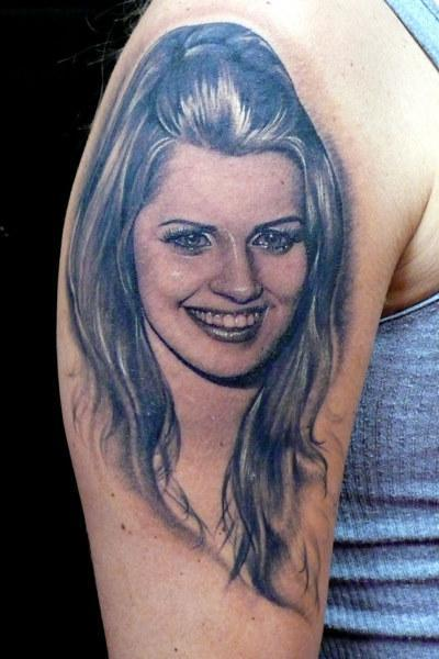 Smiling Lady Portrait Tattoo On Biceps