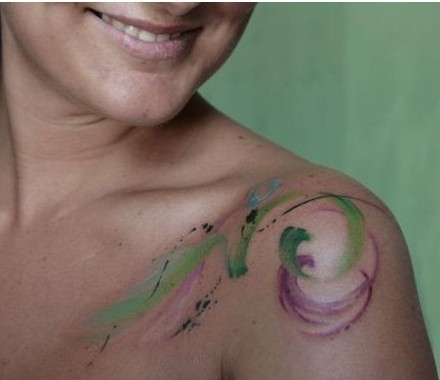 Smiling Lady With Watercolor Tattoos
