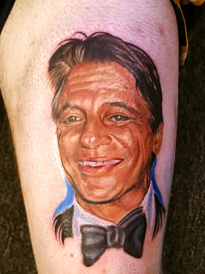 Smiling Man Portrait Tattoo