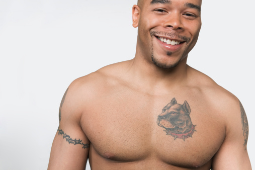 Smiling Man With Animal Tattoo On Chest