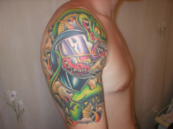 Snake And Helmet And Bone Tattoos On Half Sleeve