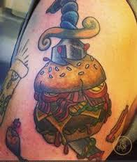 dagger-through-cheese-burger-tattoo.jpeg