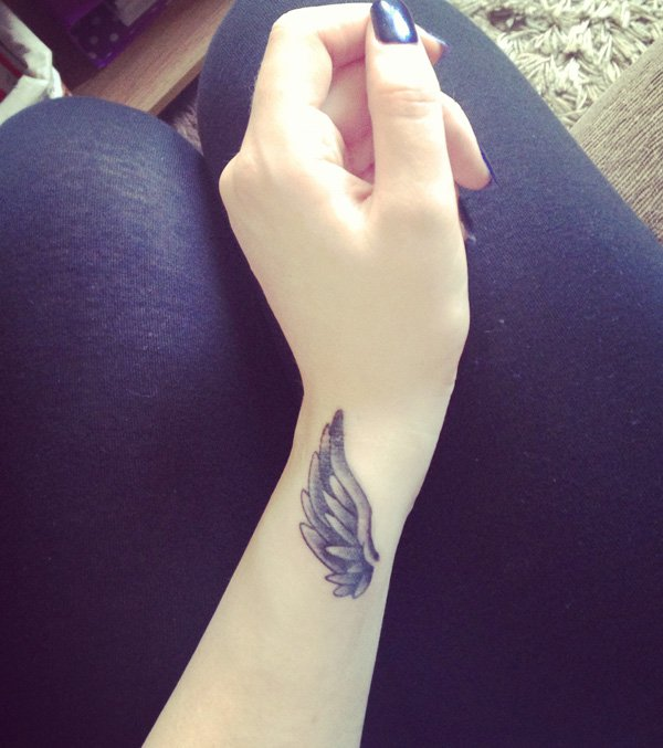 amazing grey ink wing tattoo