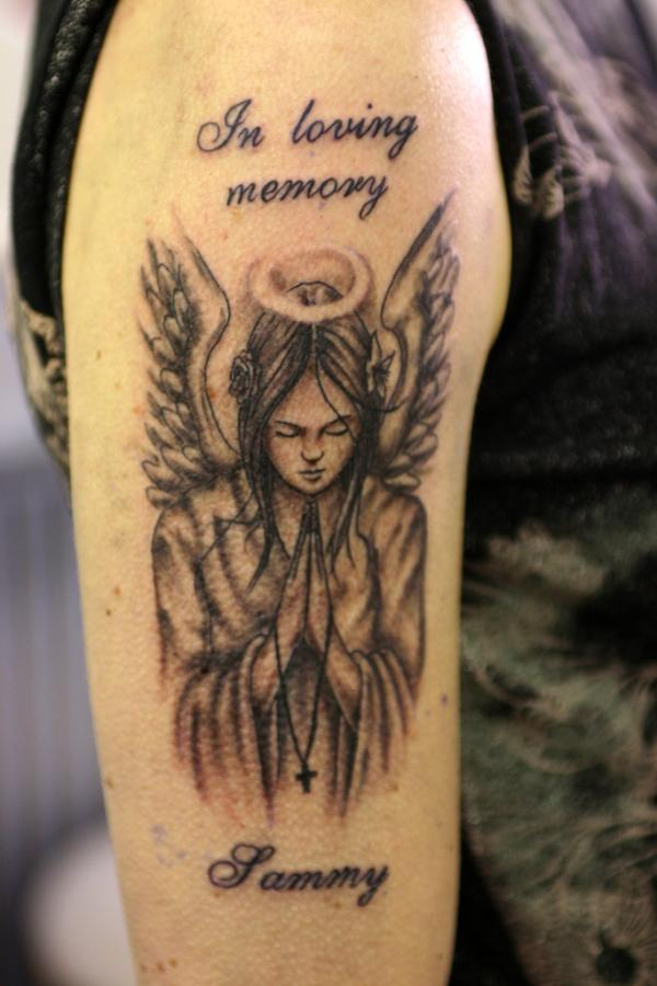 beautiful angel tattoo in loving memory carved