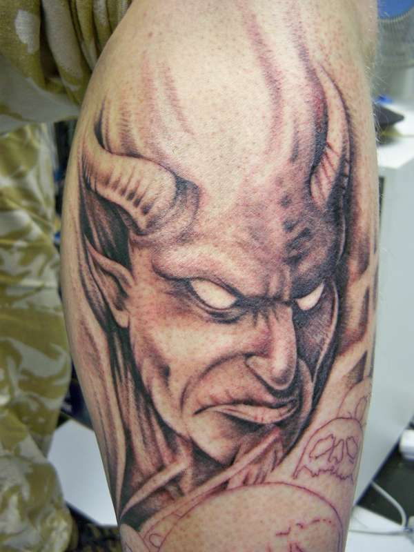 Amazing Angry Devil Face Tattoo On Calf