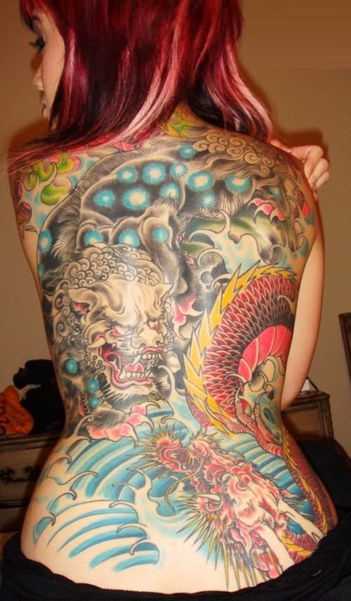 Asian Girl Showing Back Tattoo Of Colorful Dragon And Mask