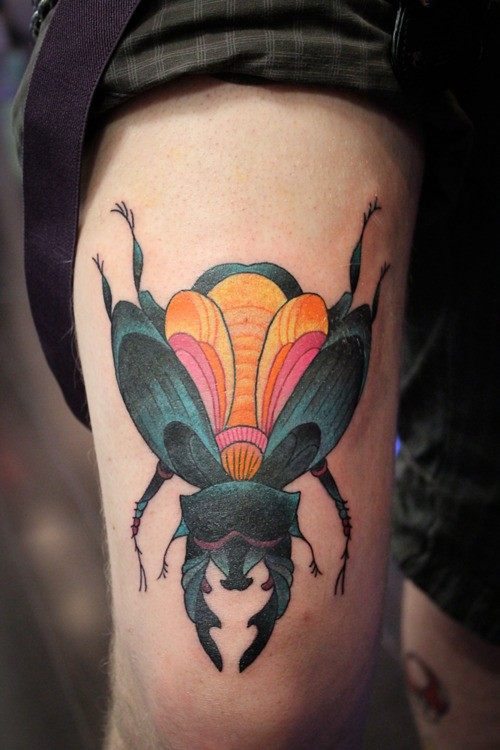 Attractive Animated Bug Tattoo Made On Girl Thigh
