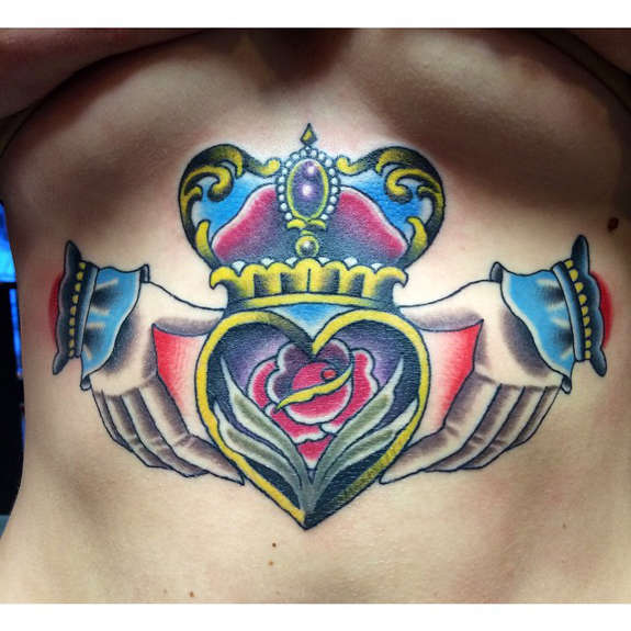 Attractive Colorful Claddagh Tattoo Design Made On Girl Front Body