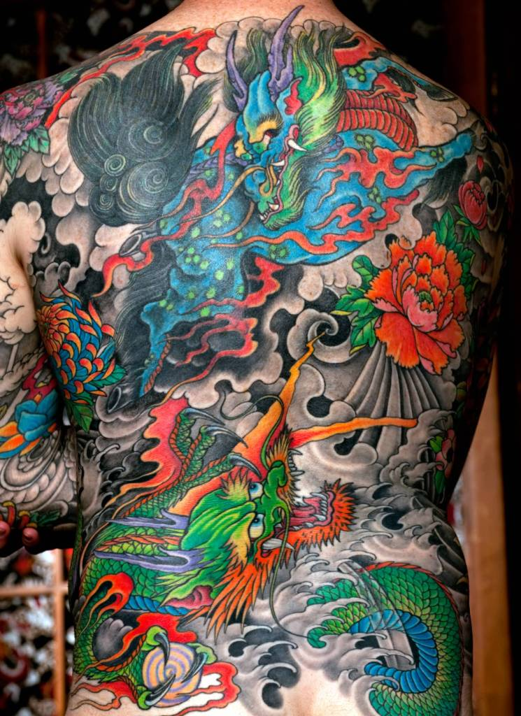 Attractive Colorful Green Asian Dragon Tattoo On Whole Back