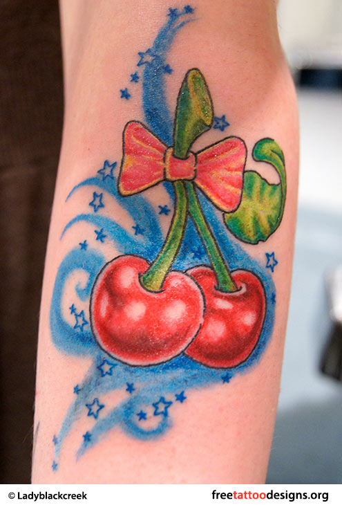 Attractive Red Cherry And Bow Tattoo Design On Forearm