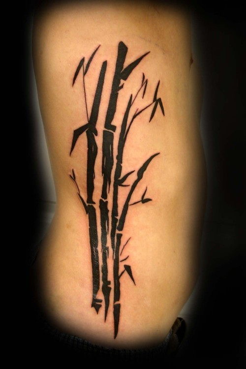 Attractive Simple Bamboo Tree Tattoo On Ribs