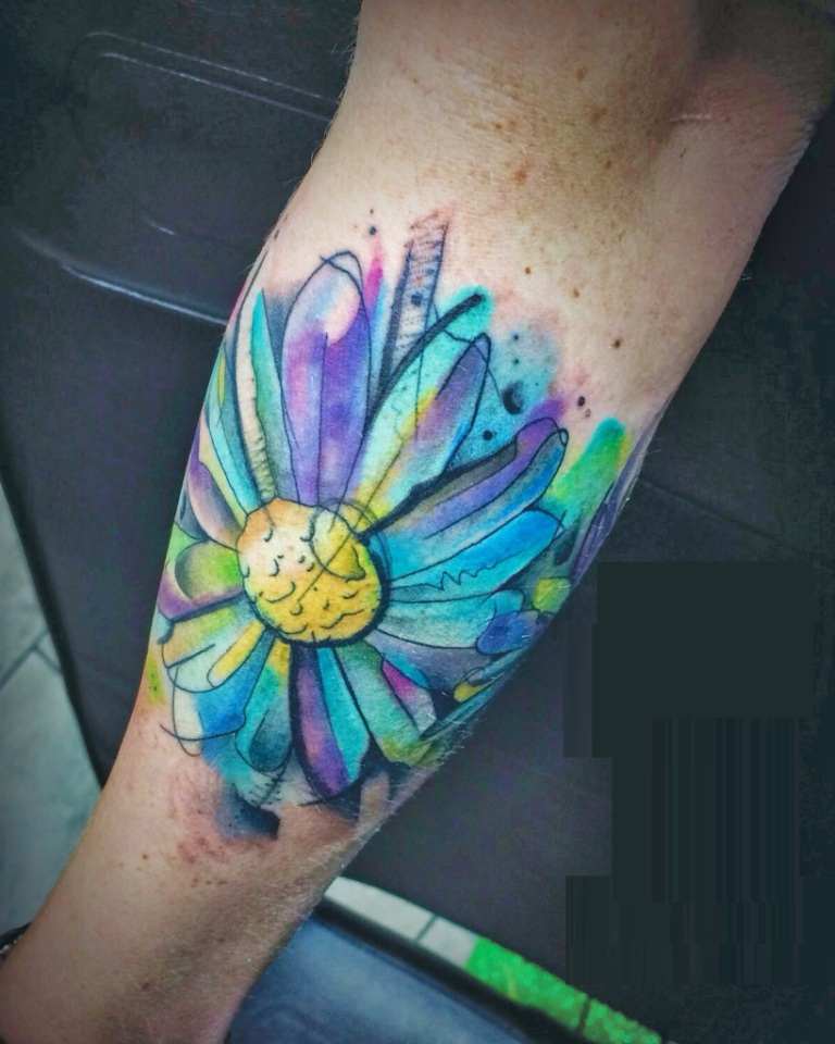 Attractive Watercolor Daisy Flower Tattoo On Calf