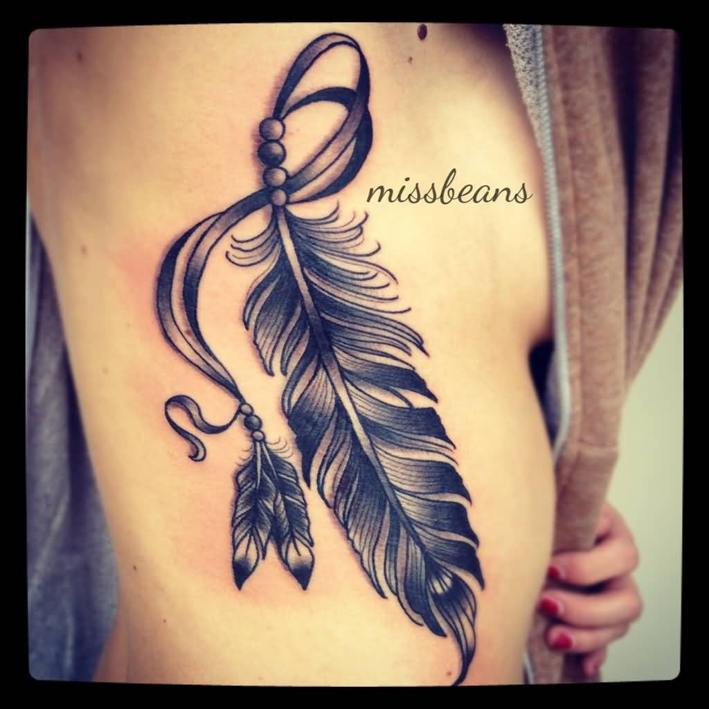 Black Ink Amazing 3d Feather Tattoo On Girl Ribs