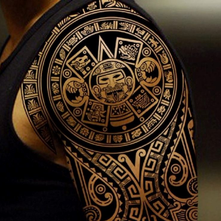 Black Ink Awesome Smiling Aztec Face Tattoo On Shoulder