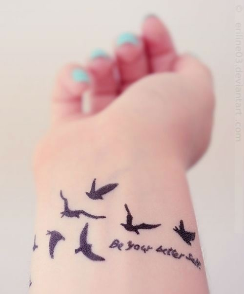 Black Ink Beautiful Flying Bird Tattoo On Girl Wrist