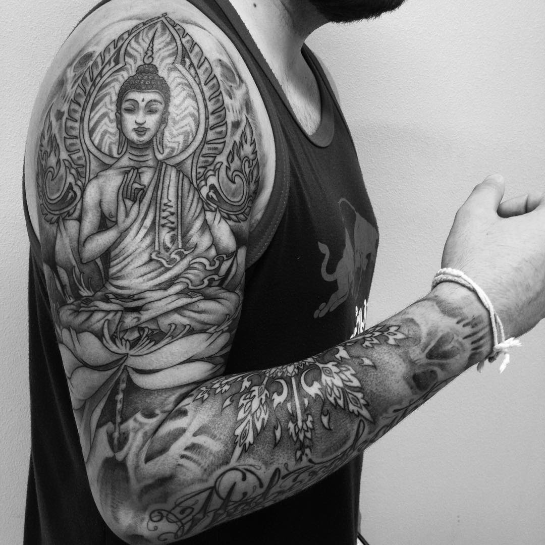 Black Ink Buddha Sitting On Flower Tattoo For Men