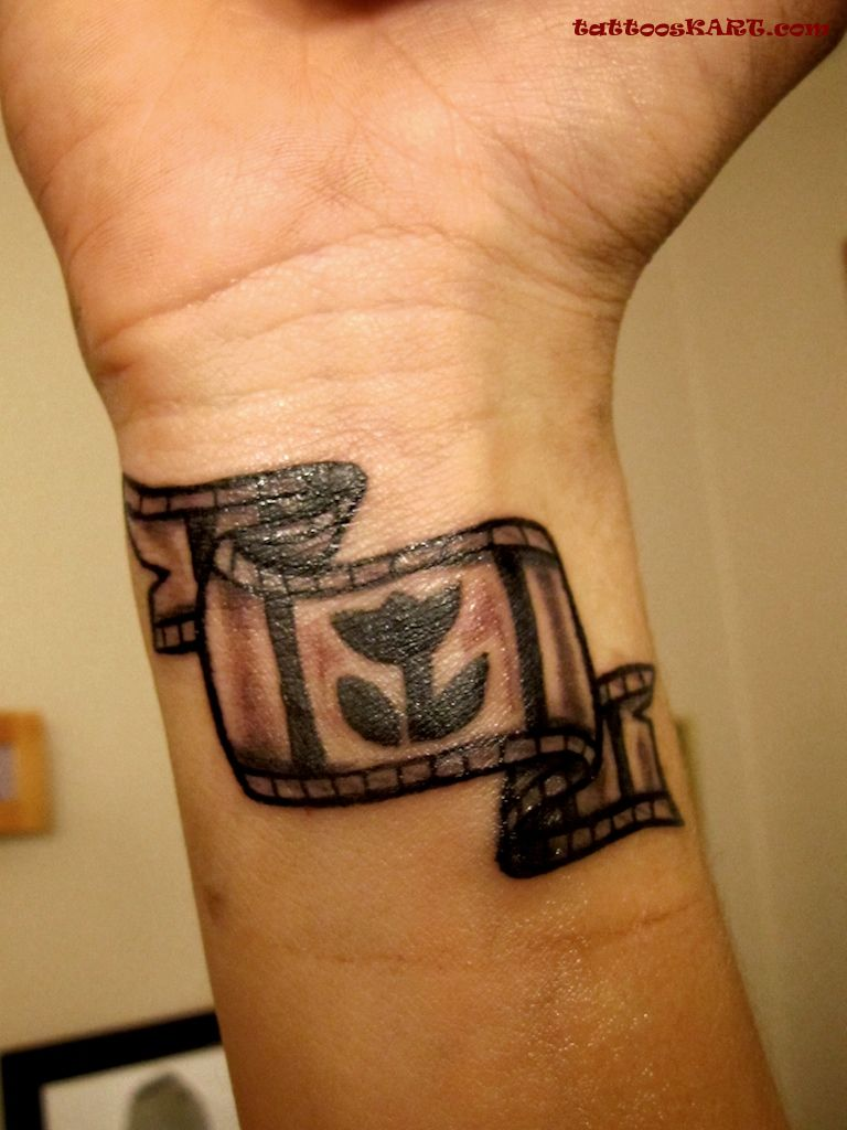 Black Ink Cinema Reel Tattoo On Men Wrist