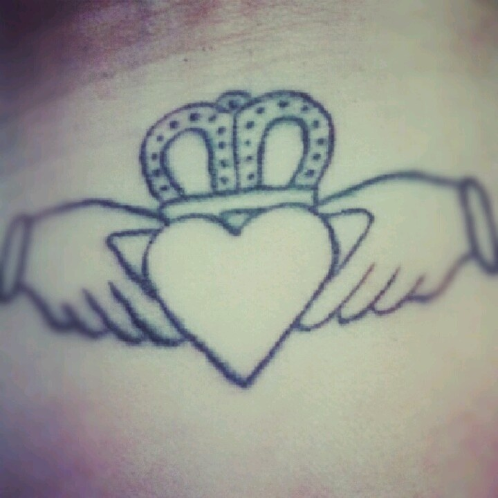 Black Ink Claddagh Tattoo Outline On Men Wrist