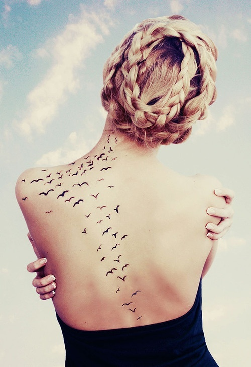 Black Ink Feminine Flying Birds Tattoo On Girl Upper Back