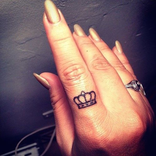 Black Ink Small Crown Tattoo On Girl Index Finger