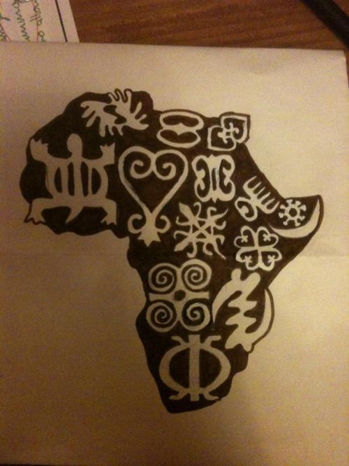 Black Ink Tribal African Sign Tattoo Design Idea
