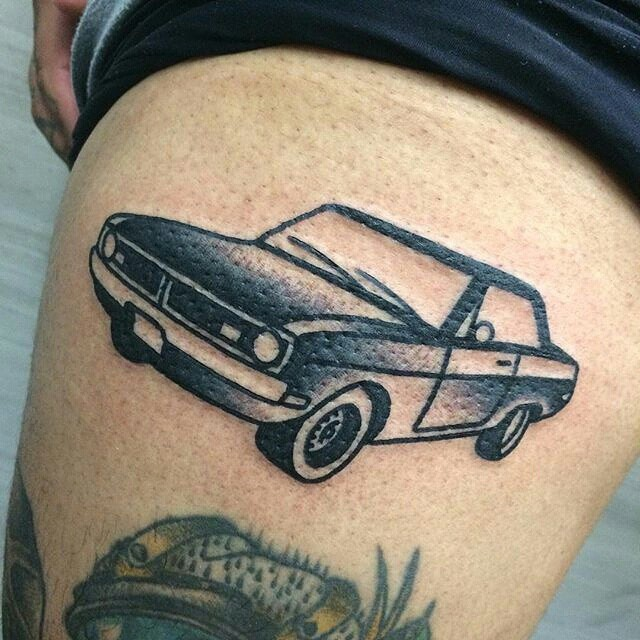 Black Ink Vintage Car Tattoo On Men Thigh
