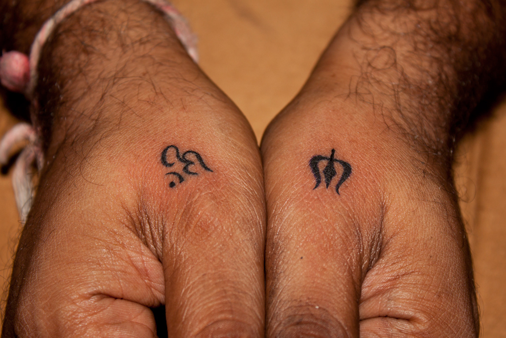 Black-Little-Trishul-With-Om-Tattoo-On-Man-Both-Hand-By-Javagreeen