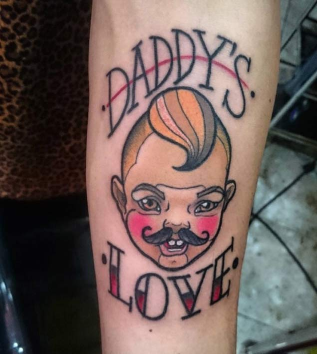Colorful Animated Baby With Muctache Tattoo On Men Sleeve