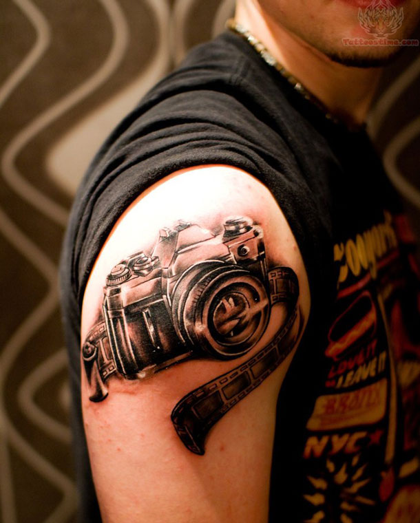 Cool 3D Black Camera Tattoo On Men Shoulder