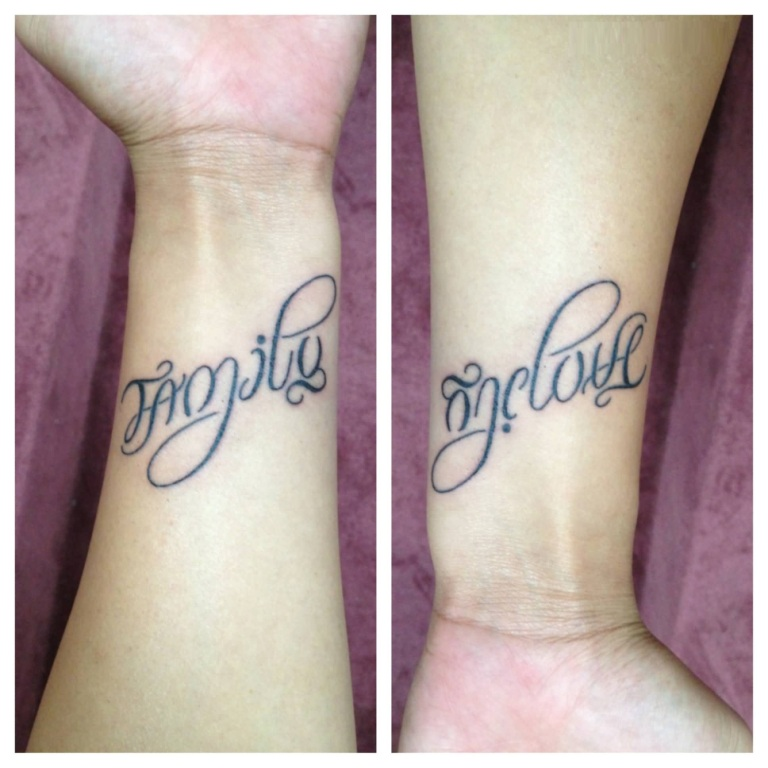 Coolest Ambigram Family Tattoo On Men Wrist