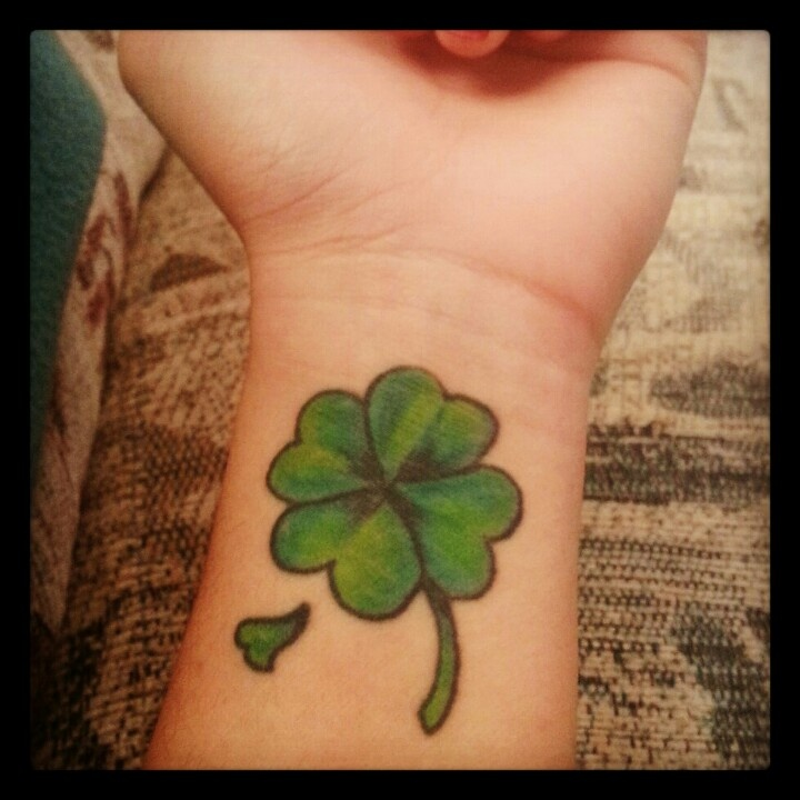 Green Ink Clover Tattoo On Men Wrist