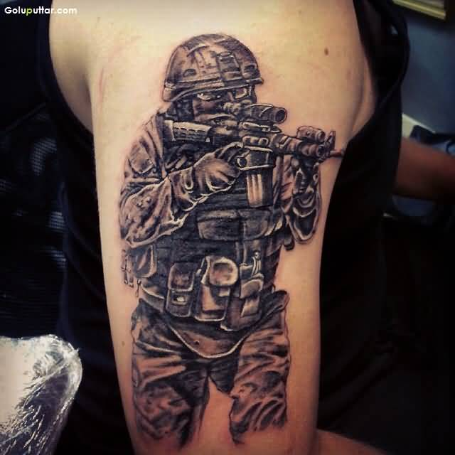 Grey Ink Amazing Army Man With Gun Tattoo On Shoulder