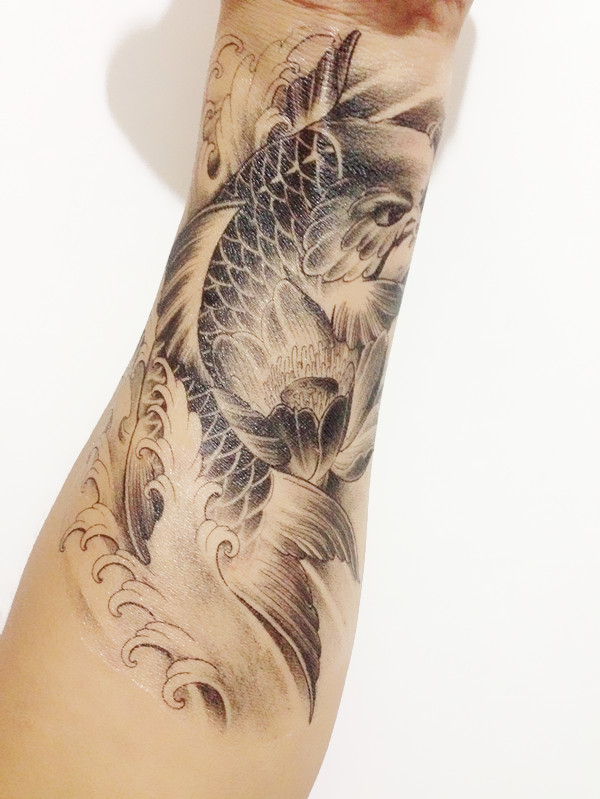 Grey Ink Amazing Carp Fish Tattoo On Forearm