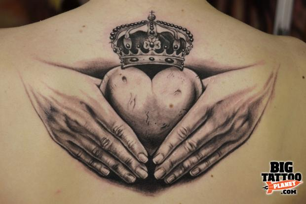 Grey Ink Claddagh Tattoo Design On Men Back
